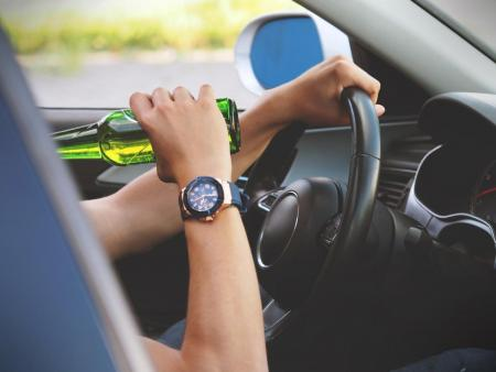 image of someone drinking and driving